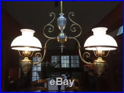 Hanging vintage electrified oil lamp with two glass shades, adjustable length to